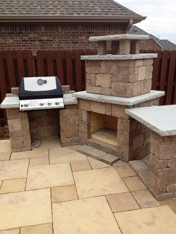 Natural Outdoor Stone Fireplace and Grill