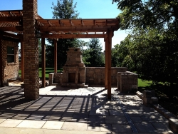 Outdoor Patio Fireplace, Stone Wall, and Pergola